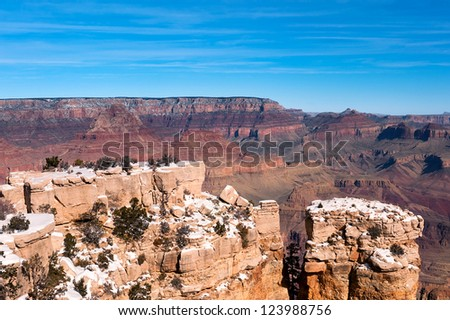 A giant ledge covered with snow at the Grand Canyon in Arizona