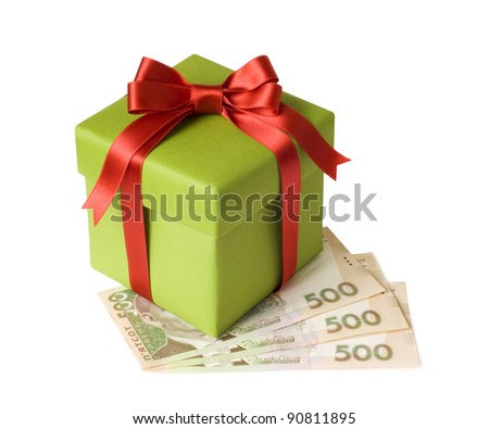 A gift and ukranian grivnas on white background
