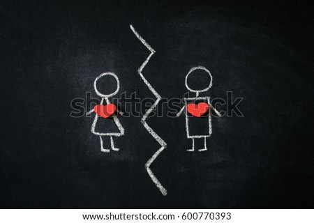A girl and a boy drawn on a blackboard representing break up