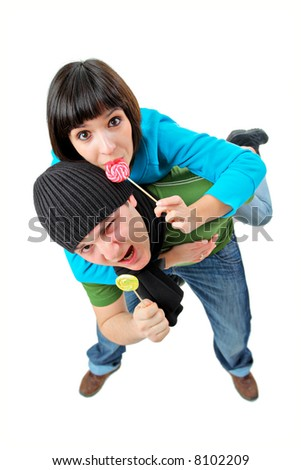 A girl and a boy with lollipops isolated on white background