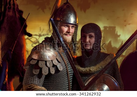 Stock Photo A girl and a guy in a medieval knight's armor