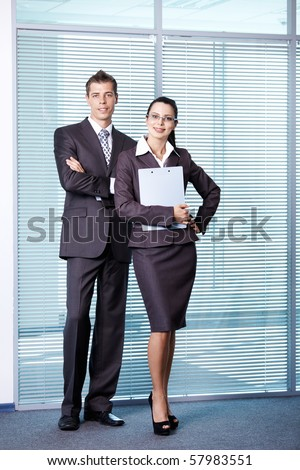 A girl and a young man in a suit at the office