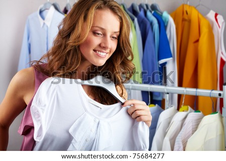 A girl choosing a t-shirt in the shop
