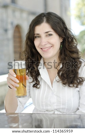 A girl drinking beer outdoors