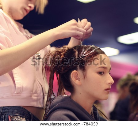 A girl getting her hair done
