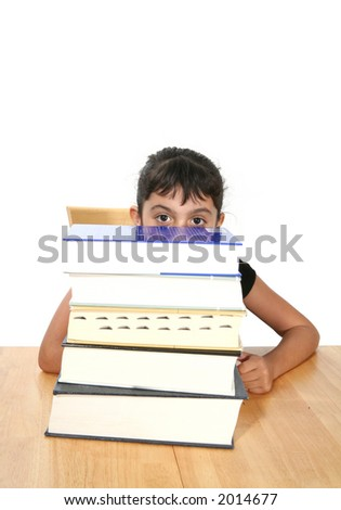 A girl hiding behind a large stack of books