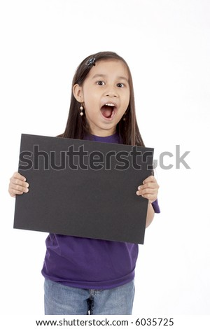 a girl holding a blank placard over a white background