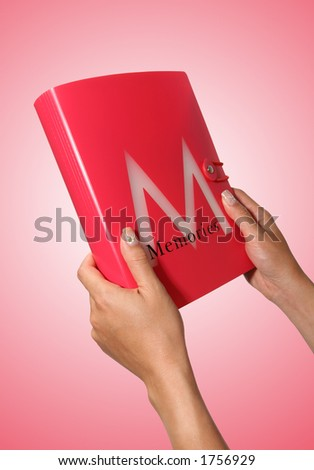 A girl holding a memory book