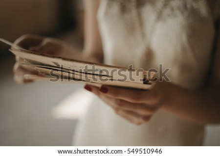 A girl holding a stack of old letters. #549510946