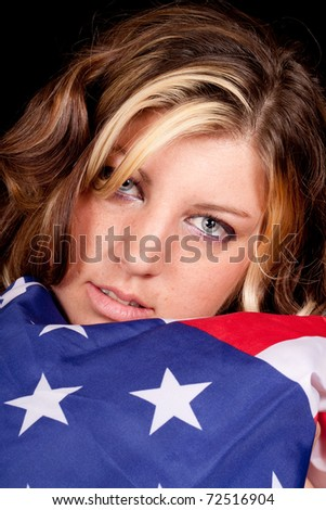 A girl holding the American flag near and dear to her.