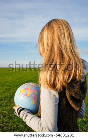 A girl holding the world in her hands