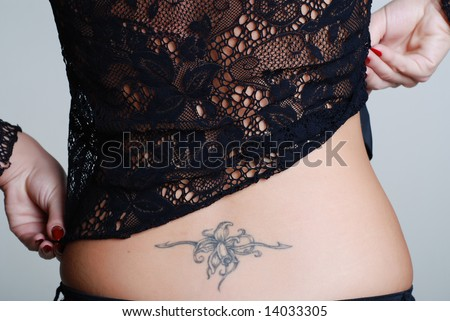 A girl in a black lace smock lifts up a smock back