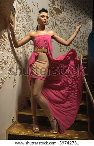 a girl in a pink dress - stock photo