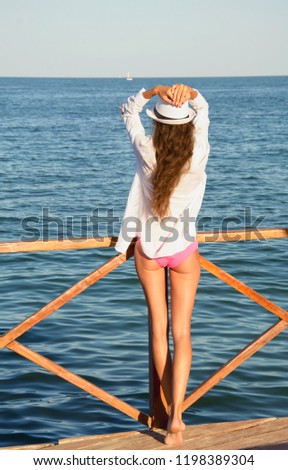 A girl in a white shirt on the background of the sea, nature, sea, summer, tourism, travel, girl, rest, beach, love, feelings, romance, girl with a hat, vacation at sea, vacation, positive, beach