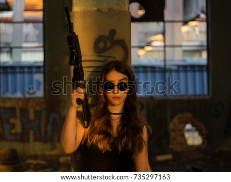 A girl in black glasses holding a rifle in a post apocalyptic setting. #735297163
