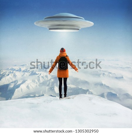 A girl is standing on the top of mountain watching a UFO in the sky. Photo with 3d rendering element and vintage film camera effects. Elements of this image furnished by NASA.