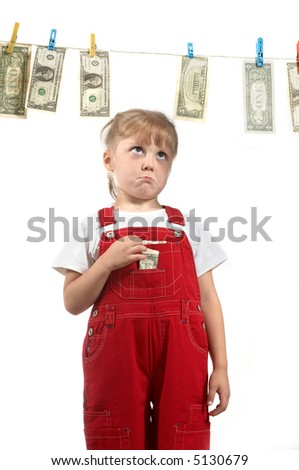 A girl looking on the clothesline with dollars