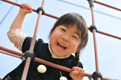 A girl playing at the playground in the park