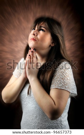 a girl prays in God
