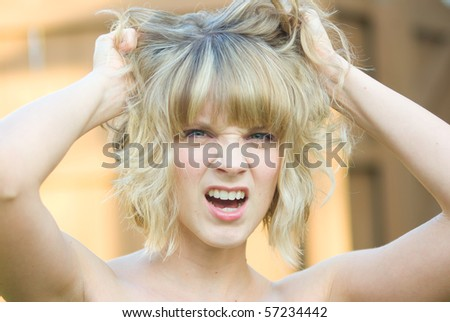A girl pulling her hair