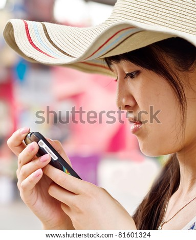 A girl  reading sms from a mobile when she is not happy
