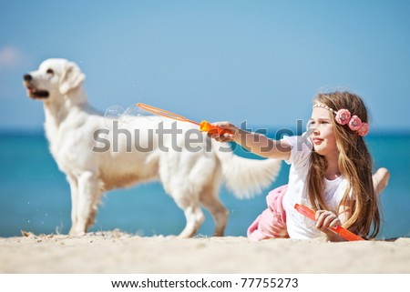 A girl rests with the dog by the sea. - stock photo