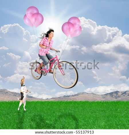 a girl riding her balloon bike in the sky - stock photo