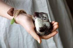 A girl's hand with felted woolen soap. The concept of a washcloth peeling. Self-care.