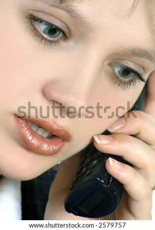 a girl speaks by phone