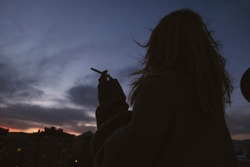a girl standing front of beautiful sky