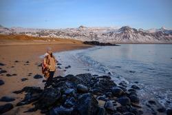 A girl standing in the beach area of snaefellsjokull national park