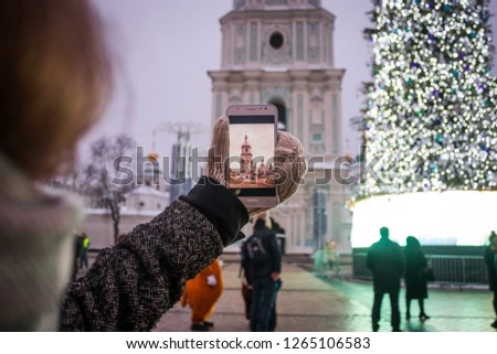 A girl takes pictures on the phone the Church Kiev Sofievskiy Sobor