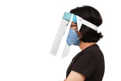 A girl wear mask and face shield to protect colona virus or Covid-19