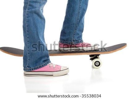 A girl wearing pink basketball shoes skateboarding on white background with copy space