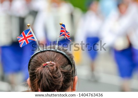 A girl wearing Union Flag deely bobbers at the annual 12th July Orange Parade, Belfast, Northern Ireland. #1404763436