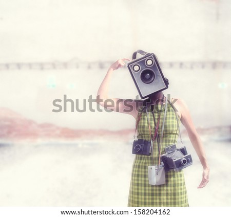 a girl with a camera for a head