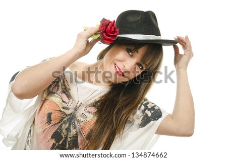 A girl with a curious dress by wearing a hat.