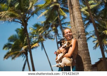 a girl with a dog enjoys life #771423619