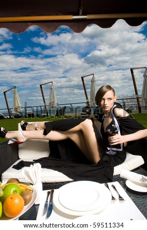 a girl with a glass of wine