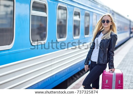 a girl with a pink suitcase is...