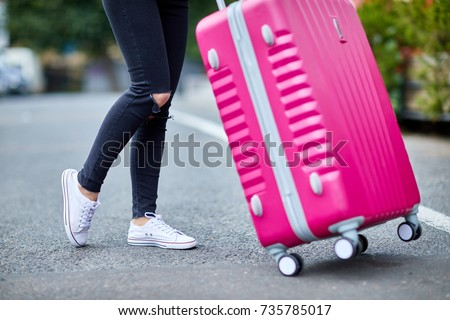 a girl with a pink suitcase...