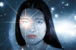 A girl with a soulful look against the background of a starry sky. Sparkling look. The concept of paranormal abilities, clairvoyance, mysticism. Elements of this image furnished by NASA