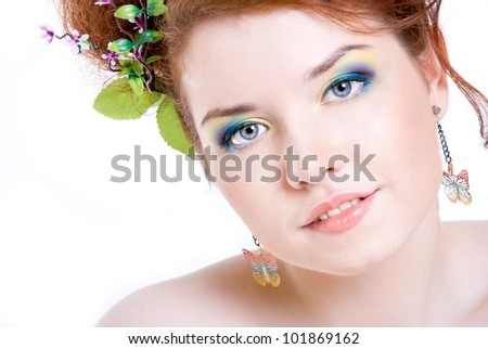 A girl with bright makeup, on white background