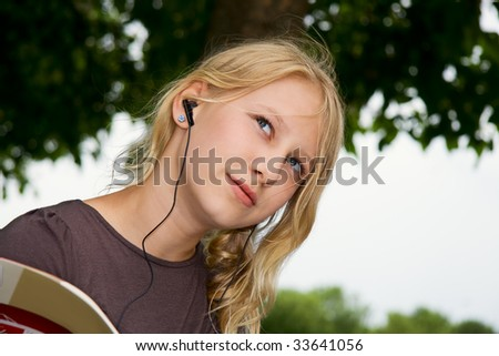 a girl with earphones look thoughtfully