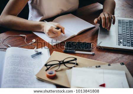 A girl writing in a notebook. Creativity, art and education concept #1013841808