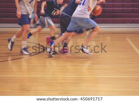 a girls basketball team running ...