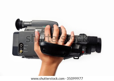 A girls hand holding a digital camera, recording
