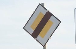 a give way or yield traffic sign on the street