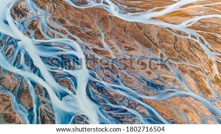 A glacial rivers from above. Aerial photograph of the river streams from Icelandic glaciers. Beautiful art of the Mother nature created in Iceland. Wallpaper background high quality photo Photo stock ©