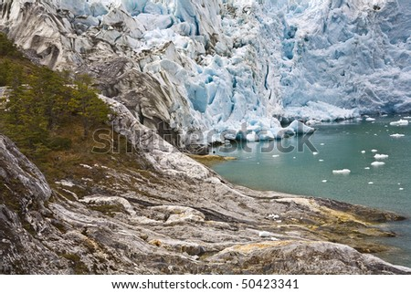 a glacier enters the water in the beagle channel, patagonia